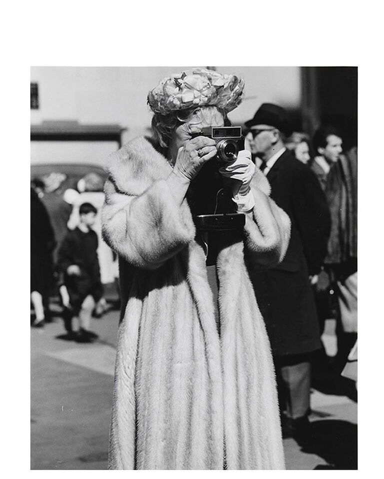 Woman in Fur Coat with Camera, Easter, St. Patrick's by Peter Hujar