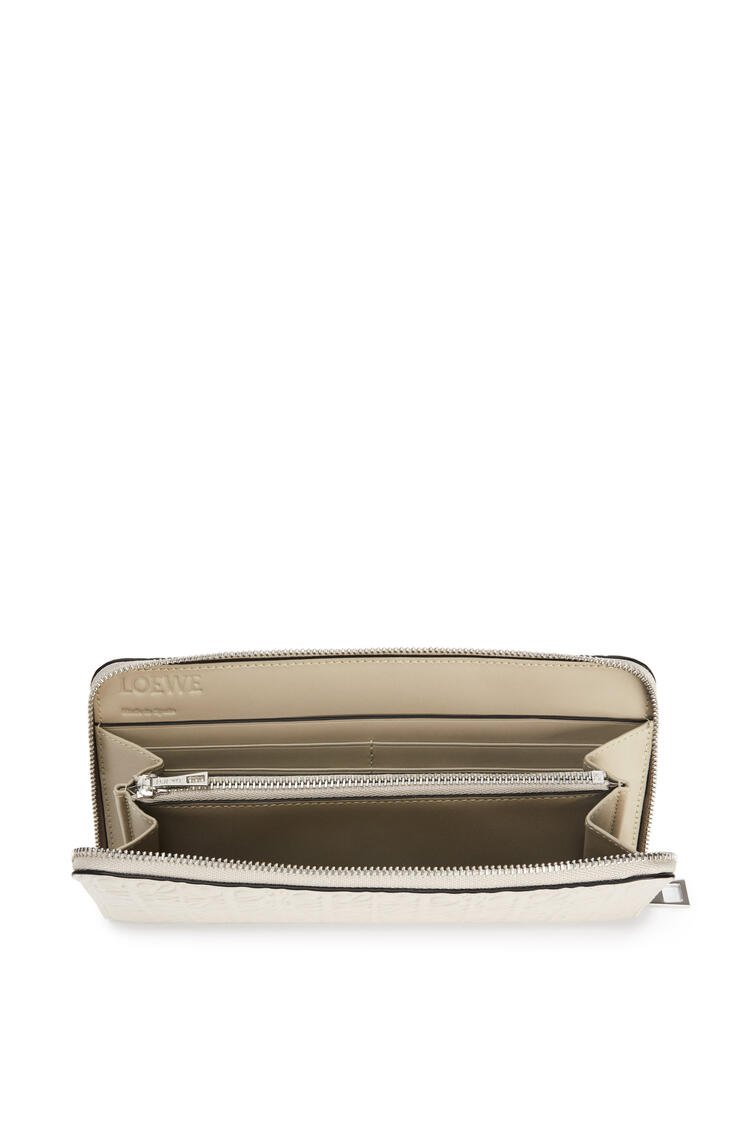 LOEWE Repeat zip around wallet in engraved calfskin Light Oat pdp_rd