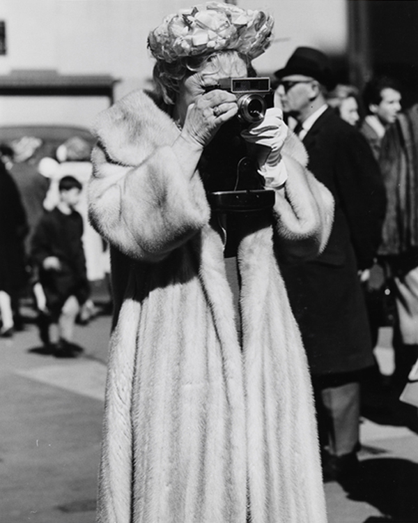 """Woman in Fur Coat with Camera, Easter, St. Patrick's"" by Peter Hujar"
